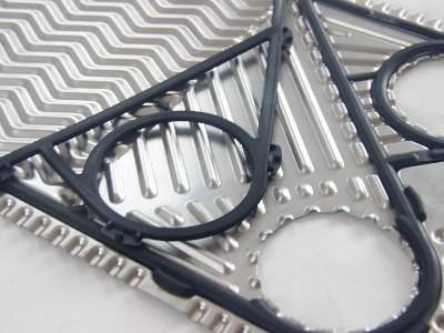 硫化压力对板式换热器密封胶垫撕裂强度、压缩永久变形率的影响